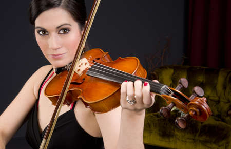 A beautiful woman plays a tune just for you Stock Photo - 15645181