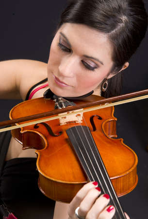 A beautiful woman plays a tune Stock Photo - 15607120