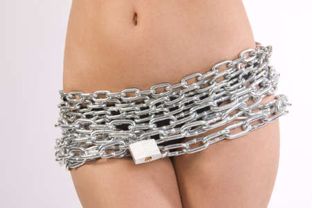 Chain and lock over a woman and her privates  Stock Photo - 15329180