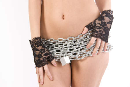A female torso wrapped in a chain and padlock photo