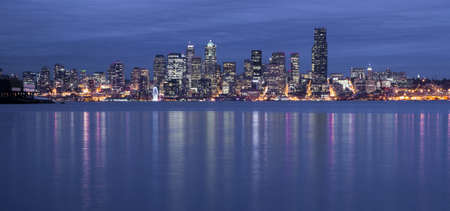 Seattle from the West Side as night falls with a storm moving in photo