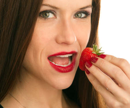 Woman eats Strawberry with her fingers