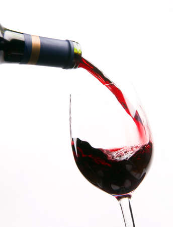 glass containers: Red Wine falls into a vessel designed for your mouth Stock Photo