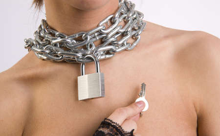 A woman offers you the key to unlock her chains Stock Photo - 15892660