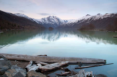 Coldwater Lake before a beautiful mountain range at dusk