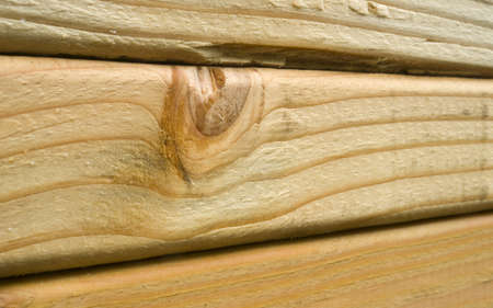 2x4 wood: A tight shot of lumber loaded onto a train for transport Stock Photo