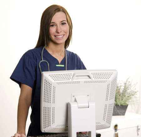 A beautiful health care worker looks up at the viewer for a moment at work Stock Photo - 16037362