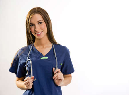 sincere: A beautiful health care worker looks up at the viewer from her work station Stock Photo