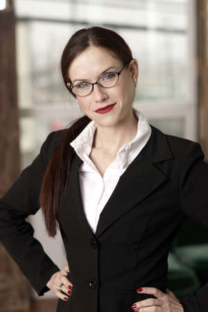 arms akimbo: A smart looking woman of business Stock Photo