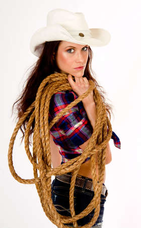A hero cowgirl in white hat holds her rope Stock Photo - 16519832