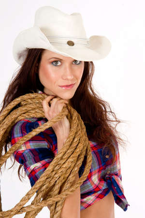 A hero cowgirl in white hat holds her rope Stock Photo - 16519829