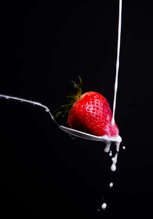 drench: A piece of fruit in a spoon milk dropping