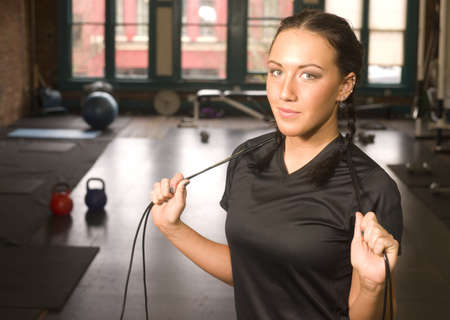 Pretty Brunette in the gym working with a jump rope