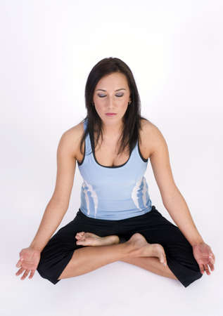 wife beater: A woman during her Yoga Practice