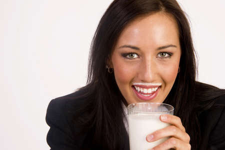 Woman gets a milk mustache enjoying a drink photo