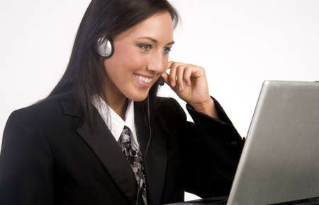 An attractive woman handles the phone on customer service Imagens
