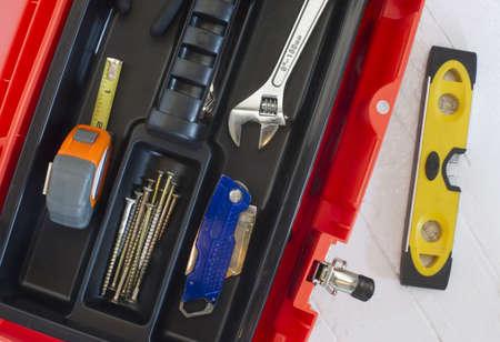 boxcutter: Orange Tool Box with Crescent Measuring Tape Level Boxcutter Screws and Multi Purpose Tool