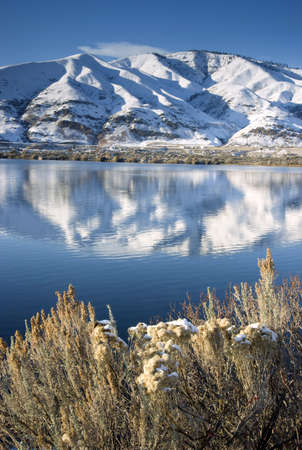 homesteads: Columbia River Flows After Fresh Snow beneath Mountain Peaks and Homesteads