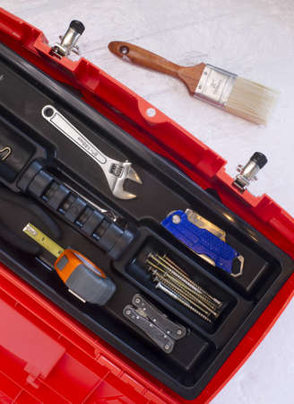 Orange Tool Box with Crescent Tape Brush Boxcutter Screws and Multi Purpose Tool photo