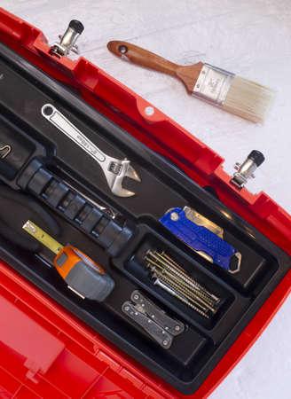 boxcutter: Orange Tool Box with Crescent Tape Brush Boxcutter Screws and Multi Purpose Tool