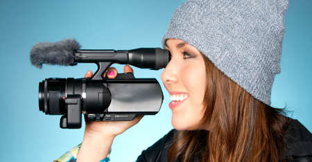 Horizontal Composition of Hip Young Adult Female Pointing Video Camera Foto de archivo