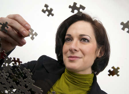 Female holding a piece of the puzzle Stock Photo - 17657529