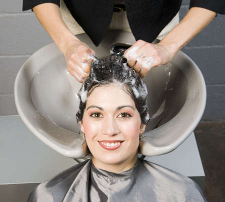 Attractive Woman Gets Spa Salon Shampoo and Conditioning photo