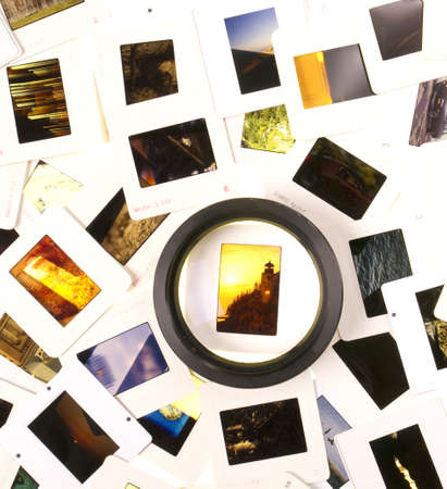 image editing: A Pile of Mounted Slide Film Sitting on The Lightbox with Loupe