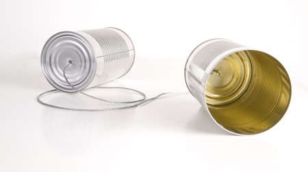 Two cans wired together somehow transfers audio to the other side Stock Photo