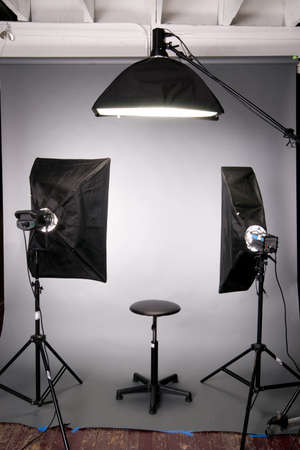 photo of accessories: Two main lights a hair light posing stool on grey seamless in the studio Stock Photo