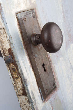 A vintage and worn door, handle and keyhole  photo