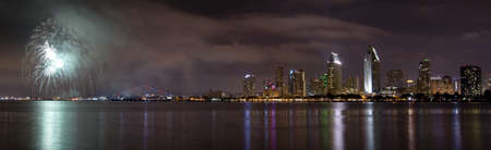 San Diego California City Skyline at Night and Fireworks Celebration Observed from Coronado Island photo