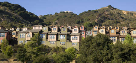 sprawl: Urban Sprawl Makes it to the Country Homes Spring up For Domestic Living on Hillside Stock Photo