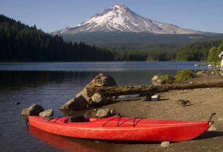 trillium lake: A Beautiful Recreation Area with a Single Red Kayak on Shore Trillium Lake Mount Hood Oregon