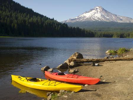 trillium lake: A Beautiful Recreation Area with a Couple Colorful Kayaks on Shore Trillium Lake Mount Hood Oregon