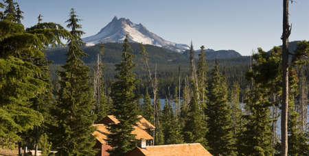 long lake: Long Panoramic View of Trees Amoung Cabin Rooftops Around Olallie Lake Near Mount Jefferson Oregon State North America