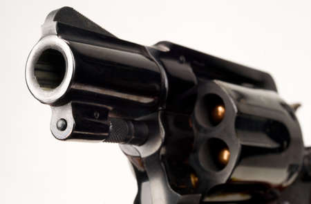 38 caliber: 38 Caliber Revolver Pistol Loaded Cylinder Gun Barrel Close Up Pointed on White Stock Photo