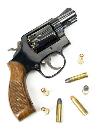 38 caliber: Wood Handled Revolver 38 Caliber Pistol Loaded Laying With Bullets Stock Photo