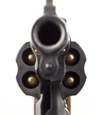 38 Caliber Revolver Pistol Loaded Cylinder Gun Barrel Close Up Pointed on White Foto de archivo