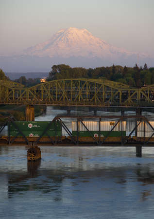 flatcar: The Puyallup River meanders down from the glaciers on Mount Rainier under bridges through cities on its way to Puget Sound