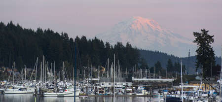 gig harbor: The sleepy harbor of the town of Gig Harbor with Mt Rainier catching the light from sunset in the background