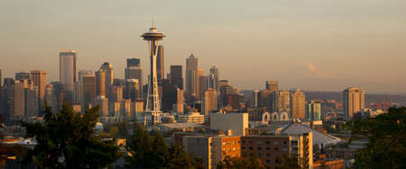 Sunset falls on the Pacific Northwest and the Space Neddle in Seattle Mt  Rainer looming in the background photo