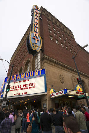 Seattle, Washington, USA - May 11, 2013: A crowd gathers in front of the Paramount Theater in Seattle waiting to enter or buy tickets for a comedy show by Russell Peters. Editorial