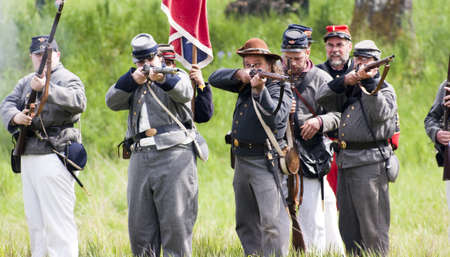 Steilacoom, Washington, USA - May 1, 2010: A group of confederate soldiers fire muskets during a Civil War re-enactment in the Pacific Northwest.