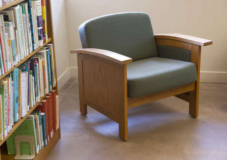Phoenix, Arizona, USA - August 3, 2012: A siting area next to a book shelf in the Schilling Library on the grounds of the Desert Botanical Gardens Phoenix Arizona.