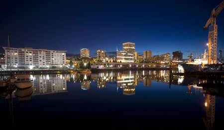 Night falls behind the Tacoma skyline and boats on Thea Foss Waterway Stock Photo - 20289737