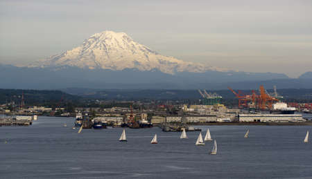 An evening boat race is conducted on the waters of Puget Sound Tacoma Washington