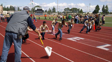 ed: Lakewood, Washington, USA - June 12, 2013: Young Students in Clover Park School Districts special needs program run a sprint race in annual event at Harry E. Lang Stadium in Lakewood WA. Editorial