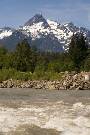 whitehorse: A raging river passes in front of Whitehorse Mountain