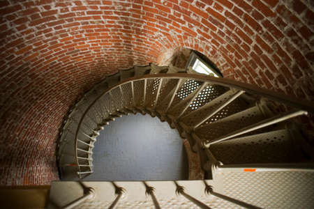 Metal spiral staircase inside historical lighthouse photo